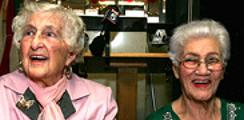102-year-old Rose Morat and Solange Elizee, 87